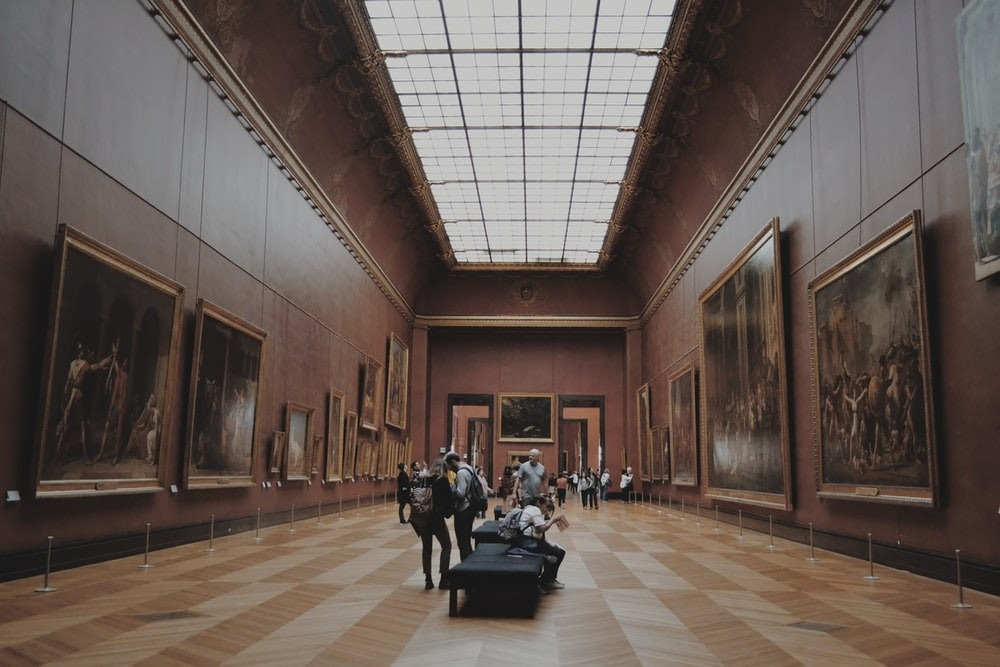 a gallery of paintings in a museum