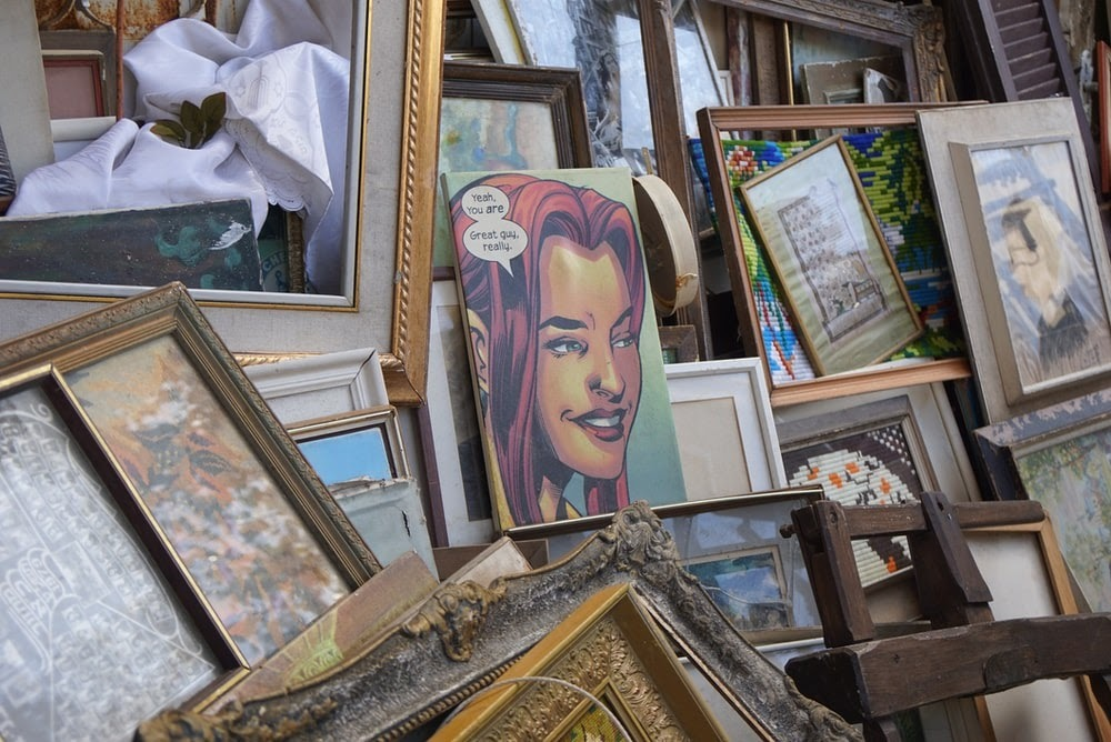 stacked frames and artwork