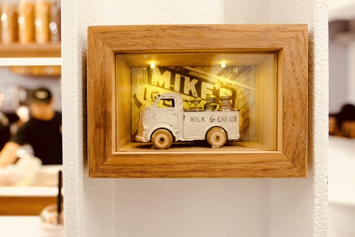 a vintage truck toy in a shadow box