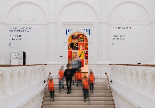 people on a staircase in a modern art museum
