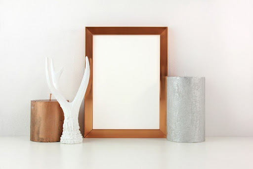 brown wood picture frame with accent pieces