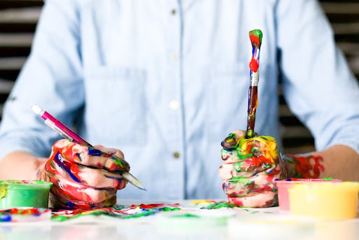 a messy painter with brushes