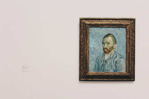a self-portrait of Vincent Van Gogh hanging on a wall